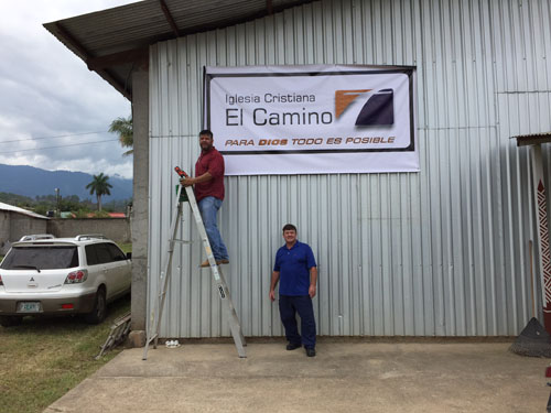 Church in Yoro Honduras, Pastor Oscar Barrientos on the ladder